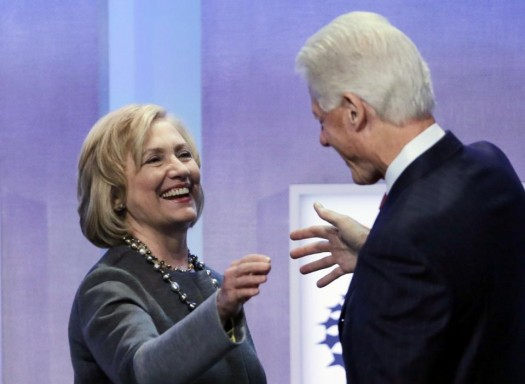 Former Secretary of State Hillary Rodham Clinton is welcomed to the stage by her husband, former President Bill Clinton, at the Clinton Global Initiative in New York.  (AP Photo/Mark Lennihan)