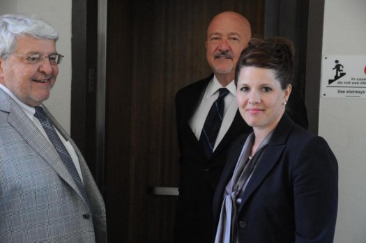 Former Republican political candidate Annette Bosworth, right, stands with her attorneys Dana Hanna, center, and Bob Van Norman, left, during a break in her trial. (AP Photo/James Nord)