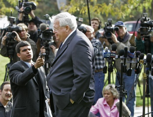 Former House Speaker, Dennis Hastert walks away from the media after answering questions about ex-Rep. Mark Foley's involvement with former pages at a news conference in Aurora, Ill. (AP Photo/M. Spencer Green, File)