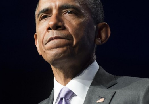 Barack Obama moved to quell a Democratic Party revolt, on the eve of a tight Congressional vote that could scuttle his trade agenda and wound his presidency (AFP Photo/Saul Loeb)