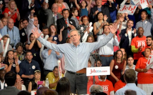 Former Republican Governor of Florida Jeb Bush (C) celebrates after announcing his candidacy for the 2016 Presidential elections, at Miami Dade College in Miami, Florida (AFP Photo/Andrew PATRON)