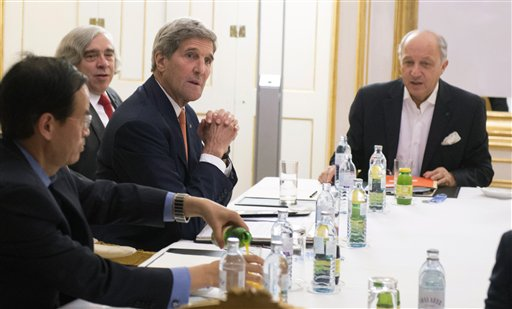 US Secretary of State John Kerry, second right, US Secretary of Energy Ernest Moniz, second left, and French Foreign Minister Laurent Fabius, right, meet at Palais Coburg Hotel, where the Iran nuclear talks are being held, in Vienna, Austria. (Joe Klamar/Pool Photo via AP)