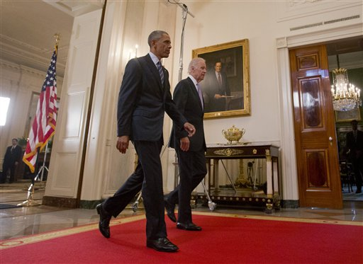President Barack Obama walks with Vice President Joe Biden, after delivering remarks in the East Room of the White House in Washington. (AP Photo/Pablo Martinez Monsivais)