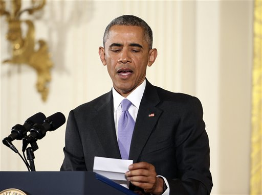 President Barack Obama looks over his notes as he answers questions about the Iran nuclear deal during a news conference in the East Room of the White House in Washington, Wednesday.  (AP Photo/Pablo Martinez Monsivais)
