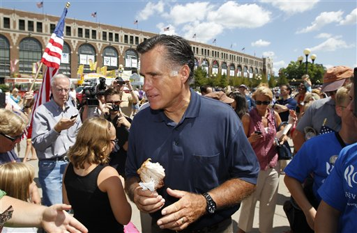FILE - In this Aug. 11, 2011, file photo, then-Republican presidential candidate and former Massachusetts Gov. Mitt Romney holds a pork chop on a stick as he campaigns at the Iowa State Fair in Des Moines, Iowa. For those who would be president, a visit to the Iowa State Fair may be the purest distillation of the campaign experience in the state that starts the voting in the race for the White House. The 10-day event starts Aug. 13, 2015, and most of the 2016 hopefuls will pass through.  (AP Photo/Charles Dharapak, File)