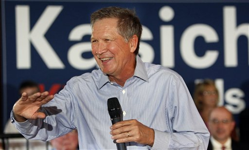 In this Aug. 12, 2015, photo, Republican presidential candidate, Ohio Gov. John Kasich speaks to a packed crowd during a campaign stop at the VFW in Derry, N.H. Even at his own rallies, Kasich is a stranger to some New Hampshire voters. Even as a mystery, Kasich has emerged as a threat to his better-known Republican rivals. He is among those betting they can capitalize on New Hampshire's tendency to favor pragmatists over ideologues.  (AP Photo/Jim Cole)