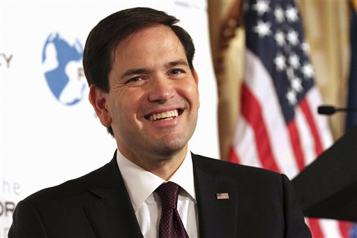 In this Friday, Aug. 14, 2015, photo, Republican presidential candidate, Sen. Marco Rubio, R-Fla. smiles while speaking during an event hosted by the Foreign Policy Initiative in New York. Rubio's slow-go campaign strategy is puzzling party operatives in Iowa and New Hampshire, states where voters are used to candidates showering them with attention early and often. (AP Photo/Tina Fineberg)