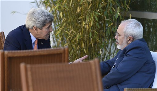 FILE - This is a Saturday, May 30, 2015 file photo of U.S. Secretary of State John Kerry, left, talks with Iranian Foreign Minister Mohammad Javad Zarif, in Geneva, Switzerland. An unusual secret agreement with a U.N. agency will allow Iran to use its own experts to inspect a site allegedly used to develop nuclear arms, according to a document seen by The Associated Press. (AP Photo/Susan Walsh, Pool, File)