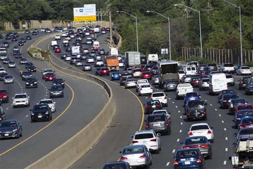 HOLD FOR RELEASE UNTIL 12:01 A.M. EDT. - Traffic crawls along the Capital Beltway during rush hour, in Greenbelt, Md., Tuesday, Aug. 25, 2015. Traffic congestion nationally reached a new peak last year and is greater than ever before, according to a report by the Texas A&M Transportation Institute and INRIX Inc. (AP Photo/Jose Luis Magana)