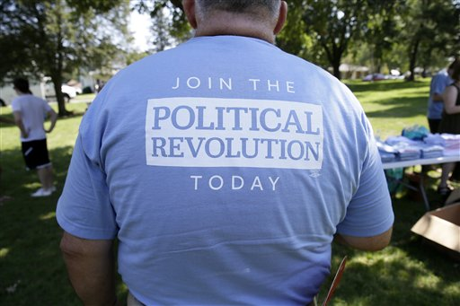 Seen is the back of a shirt on a supporter for Democratic presidential candidate, Sen. Bernie Sanders, I-Vt., during a town hall meeting, Thursday, Sept. 3, 2015, in Grinnell, Iowa. (AP Photo/Charlie Neibergall)