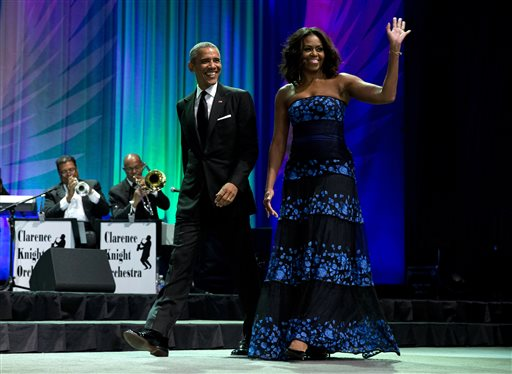President Barack Obama and first lady Michelle Obama arrive at the Congressional Black Caucus Foundation's 45th Annual Legislative Conference Phoenix Awards Dinner at the Walter E. Washington Convention Center in Washington, Saturday, Sept. 19, 2015, where the president spoke about the challenges facing black women, particularly in the areas of education, employment and criminal justice. (AP Photo/Carolyn Kaster)