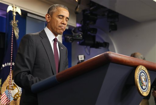 President Barack Obama pauses as he speaks in the Brady Press Briefing Room at the White House in Washington, Thursday, Oct. 1, 2015, about the shooting at the community college in Oregon. The shooting happened at Umpqua Community College in Roseburg, Ore., about 180 miles south of Portland. (AP Photo/Andrew Harnik)