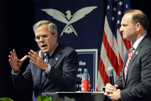 Republican presidential candidate Jeb Bush, left, speaks at Furman University in Greenville, S.C., Friday, Oct. 2, 2015. South Carolina Attorney General Alan Wilson moderated the event. (Mykal McEldowney/The Greenville News via AP)