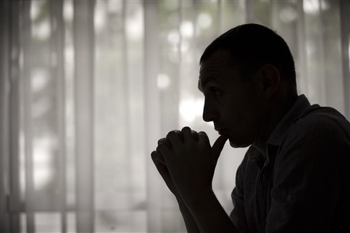 In this May 27, 2015 photo, former Moldovan police investigator Constantin Malic pauses during an interview in Chisinau, Moldova. Malic was a 27-year-old police officer when he first stumbled upon the nuclear black market in 2009. He was working on a fraud unit in the Moldovan capital, and had an informant helping police take down a euro counterfeiting ring stretching from the Black Sea to Naples, Italy. The informant, a businessman in his fifties, casually mentioned to Malic that over the years, contacts had periodically offered him radioactive material. (AP Photo/Vadim Ghirda)