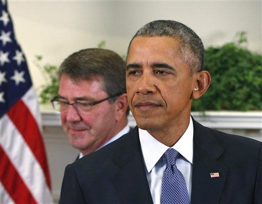 President Barack Obama, accompanied by Defense Secretary Ash Carter, arrives in the Roosevelt Room of the White House in Washington, Thursday, Oct. 15, 2015, to announce that he will keep U.S. troops in Afghanistan when he leaves office in 2017. (AP Photo/Pablo Martinez Monsivais)