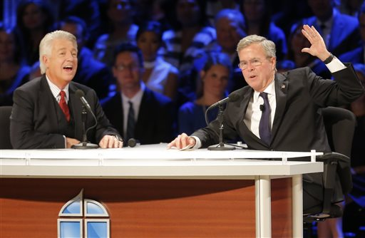 Dr. Jack Graham, left, interviews Republican presidential candidate Jeb Bush during a North Texas Presidential Forum hosted by Faith & Freedom Coalition and Prestonwood Baptist Church, Sunday, Oct. 18, 2015, in Plano, Texas. (AP Photo/Brandon Wade)