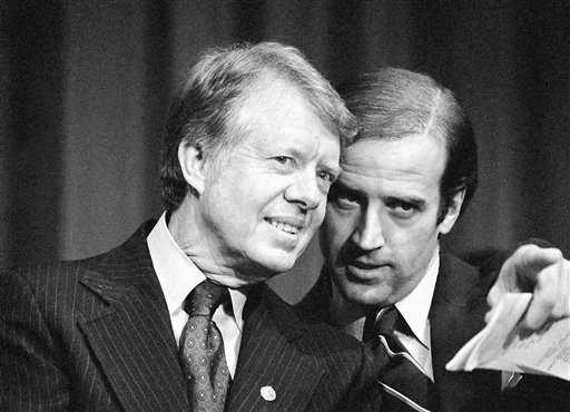 FILE - In this Feb. 20, 1978, file photo, President Jimmy Carter listens to Sen. Joseph R. Biden, D-Del., as they wait to speak at fund raising reception at Padua Academy in Wilmington, Del. Biden's storied political career will end much the way it started nearly half a century ago: shaped by crushing personal tragedy that shook his confidence in his own ability to lead. In deciding not to run for president, Biden has turned away from months of preparations and countless hours that had put him on the verge of a third presidential campaign. (AP Photo/Barry Thumma, File)