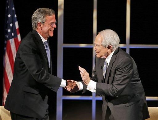 Republican presidential candidate former Florida Gov. Jeb Bush shakes hands with Rev. Pat Robertson, right, after a Presidential candidate forum at Regent University in Virginia Beach, Va., Friday, Oct. 23, 2015. (AP Photo/Steve Helber)