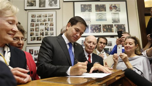 Republican presidential candidate Sen. Marco Rubio, R-Fla. signs papers to be on the nation's earliest presidential primary ballot, Thursday, Nov. 5, 2015, at The Secretary of State's office in Concord, N.H. (AP Photo/Jim Cole)