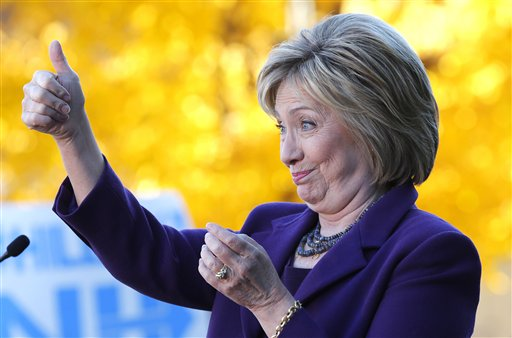 In this Nov. 9, 2015, photo, Democratic presidential candidate Hillary Rodham Clinton acknowledges supporters after filing papers to be on the Nation's earliest presidential primary ballot at The Secretary of State's office in Concord, N.H. Clinton has locked up public support from half of the Democratic insiders who cast ballots at the party's national convention, giving her a commanding advantage over her rivals for the party's presidential nomination. (AP Photo/Jim Cole)