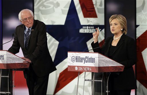 Hillary Rodham Clinton, right, makes a point as Bernie Sanders listens during a Democratic presidential primary debate, Saturday, Nov. 14, 2015, in Des Moines, Iowa. (AP Photo/Charlie Neibergall)
