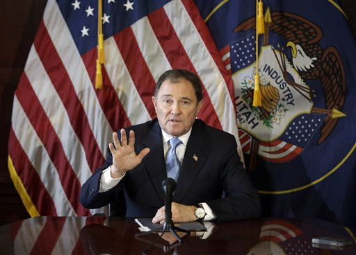 FILE - In this Feb. 5, 2015, file photo, Utah Gov. Gary Herbert speaks to reporters during a news conference at the Utah State Capitol in Salt Lake City. Herbert is ordering a review of security checks for refugees coming to Utah on the heels of the last week's attacks in Paris. The Republican governor said in a statement Monday, Nov. 16, 2015, that he wants state and federal authorities to reevaluate how they screen refugees. (AP Photo/Rick Bowmer, File)