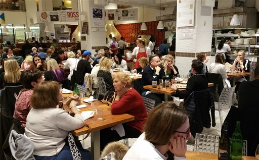 """Customers dine at the gourmet emporium Eataly in New York Monday, Nov. 16, 2015.   From cafes in Manhattan to a throng of football tailgaters in the heartland, Americans asked a gnawing question in the aftermath of the carnage in Paris: Can anything be done in the United States to prevent a similar """"soft-target"""" attack, in which well-organized extremists strike at the restaurants, bars and gathering spots that stand out for being ordinary? (AP Photo/Verena Dobnik)"""