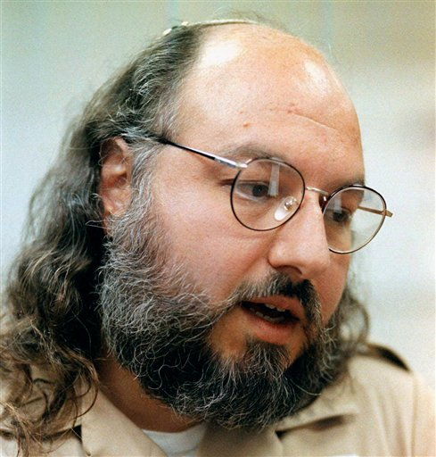 FILE - In this May 15, 1998 file photo, Jonathan Pollard speaks during an interview in a conference room at the Federal Correction Institution in Butner, N.C. Pollard is set to be paroled from a federal prison in North Carolina on Friday, 30 years after he was caught selling American intelligence secrets to Israel. (AP Photo/Karl DeBlaker, File)