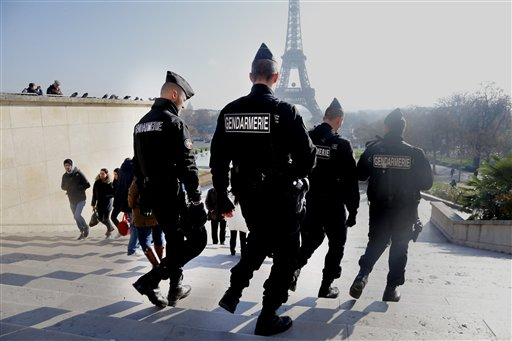 French gendarmes officers patrol near the Eiffel Tower, in Paris, Monday Nov. 23, 2015.  French President Francois Hollande will preside over a national ceremony on Nov. 27 honoring the at least 130 victims of the deadliest attacks on France in decades.  (AP Photo/Jacques Brinon)