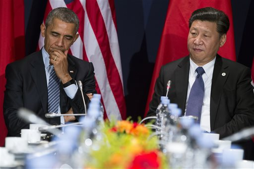 U.S. President Barack Obama, left, meets with Chinese President Xi Jinping during their meeting held on the sidelines of the COP21, United Nations Climate Change Conference, in Le Bourget, outside Paris, Monday, Nov. 30, 2015. (AP Photo/Evan Vucci)