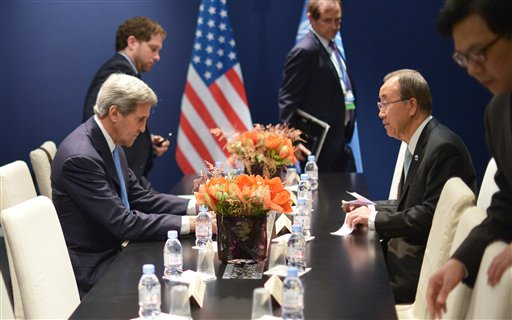 US Secretary of State John Kerry, left, and United Nations Secretary General Ban Ki-moon meet on the sidelines  of the COP 21 United Nations conference on climate change,  in Le Bourget, on the outskirts of Paris on Friday Dec. 11, 2015.  (Mandel Ngan, Pool via AP)