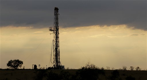 FILE - In this May 9, 2012 file photo, a drilling rig is seen near Kennedy, Texas. The four-decade-old ban on exporting crude oil may end up getting lifted in a must-pass year-end spending bill lawmakers are scrambling to complete. Lifting the ban is a top ask for GOP negotiators working on the sprawling legislation. In return, Democrats are seeking various environmental priorities, including making permanent tax credits for solar and wind energy production. (AP Photo/Eric Gay, File)