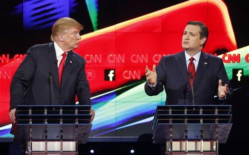 Donald Trump, left, watches as Ted Cruz speaks during the CNN Republican presidential debate at the Venetian Hotel & Casino on Tuesday, Dec. 15, 2015, in Las Vegas. (AP Photo/John Locher)