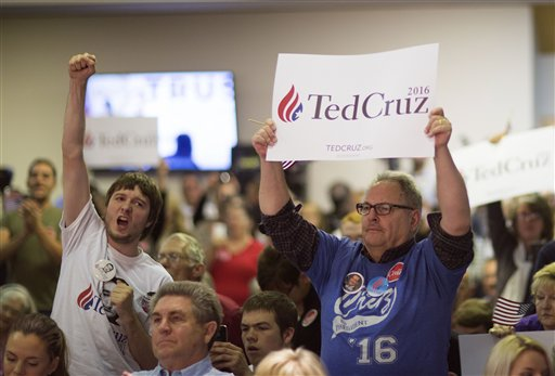 Supporters cheer as Republican presidential candidate Sen. Ted Cruz, R-Texas speaks during a campaign stop in Oklahoma City, Wednesday, Dec. 23, 2015. (AP Photo/J Pat Carter)
