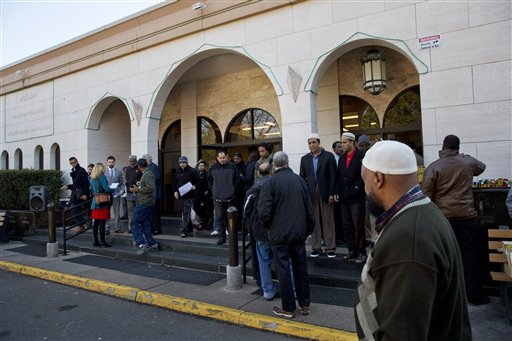 In this photo taken Dec. 4, 2015, people arrive for Friday prayers at Dar al-Hijrah Mosque in Falls Church, Va. Americans place a higher priority on preserving the religious freedom of Christians than other faith groups, ranking Muslims as the least deserving of the protections, according to a new poll from The Associated Press-NORC Center for Public Affairs Research.  (AP Photo/Jacquelyn Martin)