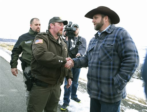 Harney County Sheriff Dave Ward meets with Ammon Bundy at a remote location outside the Malheur National Wildlife Refuge on Thursday, Jan. 7, 2016, near Burns, Ore. Three Oregon sheriffs met Thursday with the leader of an armed group occupying a federal wildlife refuge and asked them to leave, after residents made it clear they wanted them to go home. Ward said via Twitter that he asked Bundy to respect the wishes of residents.  Ward said the two sides planned to talk again Friday. (Beth Nakamura/The Oregonian via AP)