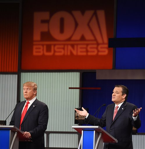 Republican presidential candidate, Sen. Ted Cruz, R-Texas, right, speaks as Republican presidential candidate, businessman Donald Trump  looks on during the Fox Business Network Republican presidential debate at the North Charleston Coliseum, Thursday, Jan. 14, 2016, in North Charleston, S.C. (AP Photo/Rainier Ehrhardt)