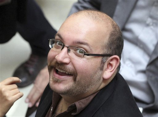 FILE - In this photo April 11, 2013 file photo, Jason Rezaian, an Iranian-American correspondent for the Washington Post, smiles as he attends a presidential campaign of President Hassan Rouhani in Tehran, Iran. A source close to Iran's judiciary confirmed to The Associated Press, Saturday, Jan. 16, 2016 that jailed Washington Post bureau chief Jason Rezaian is one of four dual-national prisoners freed by Iran's government and previously announced on Iranian state television without naming those released.  (AP Photo/Vahid Salemi, File)