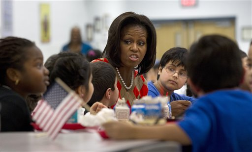 FILE - In this Jan. 25, 2012 file photo, First lady Michelle Obama has lunch with school children at Parklawn elementary school in Alexandria, Va.   A bipartisan Senate bill released Monday would revise healthier meal standards put into place over the last few years to give schools more flexibility in what they serve the nation's schoolchildren, easing requirements on whole grains and delaying an upcoming deadline to cut sodium levels on the lunch line.   (AP Photo/Pablo Martinez Monsivais)