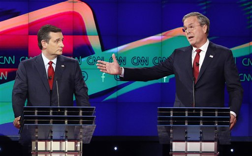 """FILE - In this Dec. 15, 2015 file photo, former Florida Gov. Jeb Bush, right, makes a point as Sen. Ted Cruz, R-Texas listens on during the Republican presidential debate in Las Vegas. Ted Cruz once proudly wore a belt buckle reading """"President of the United States"""" borrowed from George H.W. Bush. He campaigned and worked for, and helped write a book lavishing praise on, that former president's son, Dubya. And the endorsement of George P. Bush, the family's latest rising political star, lent credibility to Cruz's then little-known 2012 Senate campaign. (AP Photo/John Locher, File)"""