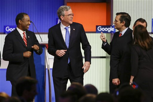 Republican presidential candidates (L-R) retired neurosurgeon Ben Carson, former Florida Gov. Jeb Bush, and Sen. Ted Cruz, R-Texas talks after the Republican presidential primary debate, Thursday, Jan. 28, 2016, in Des Moines, Iowa. (AP Photo/Charlie Neibergall)
