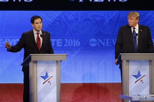 Republican presidential candidate, Sen. Marco Rubio, R-Fla., answers a question as Republican presidential candidate, businessman Donald Trump listens during a Republican presidential primary debate hosted by ABC News at the St. Anselm College  Saturday, Feb. 6, 2016, in Manchester, N.H. (AP Photo/David Goldman)