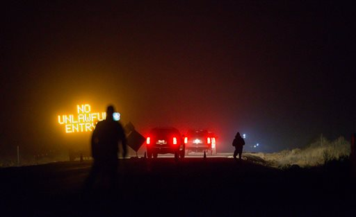 Three SUV proceeds through the Narrows roadblock near Burns, Ore., as FBI agents have surrounded the remaining four occupiers at the Malheur National Wildlife Refuge, on Wednesday, Feb.10, 2016. The four are the last remnants of an armed group that seized the Malheur National Wildlife Refuge on Jan. 2 to oppose federal land-use policies.  (Thomas Boyd/The Oregonian via AP)