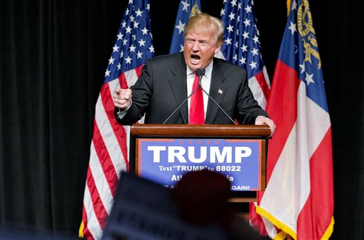 "In this Feb. 21, 2016, photo, Republican presidential candidate Donald Trump speaks at a campaign event in Atlanta. Trump has repeated inaccurate and racially-charged crime statistics, reposted pledges of support from white supremacists and retweeted dubious questions about the citizenship of his presidential rivals to an online following that includes more than six million people on Twitter alone. His response when challenged? To dismiss it all as nothing more than a harmless ""retweet."" (AP Photo/David Goldman)"
