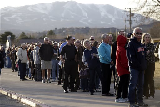 Voters line up to to vote in the Republican party caucus Tuesday, Feb. 23, 2016, in Reno, Nev. (AP Photo/Marcio Jose Sanchez)