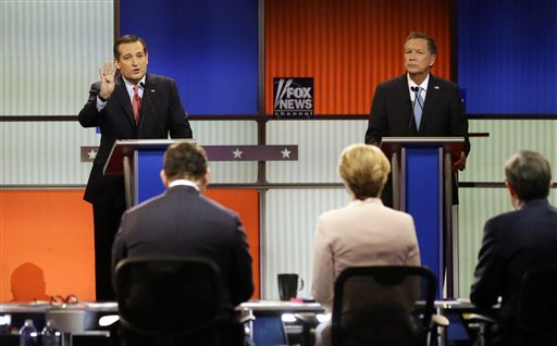Republican presidential candidate, Sen. Ted Cruz, R-Texas, argues a point as Ohio Gov. John Kasich listens during a Republican presidential primary debate at Fox Theatre, Thursday, March 3, 2016, in Detroit. (AP Photo/Carlos Osorio)