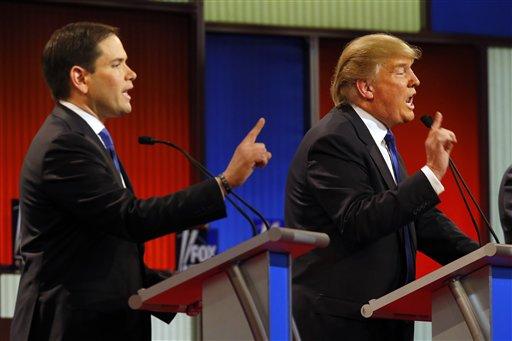 Republican presidential candidates, Sen. Marco Rubio, R-Fla., and businessman Donald Trump argue during a Republican presidential primary debate at Fox Theatre, Thursday, March 3, 2016, in Detroit. (AP Photo/Paul Sancya)