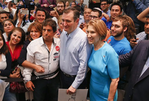 Republican presidential candidate, Sen. Ted Cruz, R-Texas, and Former Republican presidential candidate Carly Fiorina pose for photographs during a campaign rally in Miami, Fla., Wednesday, March 9, 2016. (AP Photo/Paul Sancya)