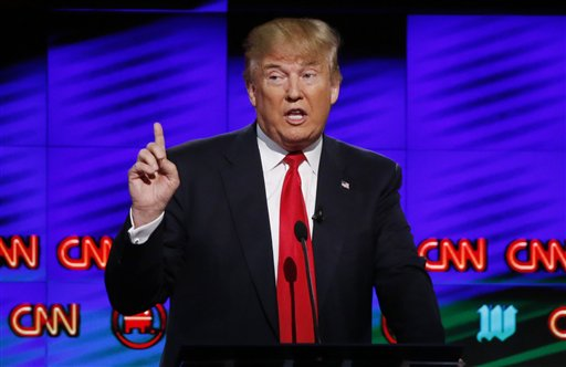 """FILE -- In this Thursday, March 10, 2016, file photo, Republican presidential candidate, businessman Donald Trump, speaks during the Republican presidential debate sponsored by CNN, Salem Media Group and the Washington Times at the University of Miami, in Coral Gables, Fla. A top security official in Dubai, Lt. Gen. Dhahi Khalfan Tamim, warned of a """"clash of civilizations"""" if Donald Trump wins the U.S. general electiont in a post on Twitter Friday . In Thursday's debate, Trump refused to back away from his recent statement that """"Islam hates the West."""" (AP Photo/Wilfredo Lee, File)"""