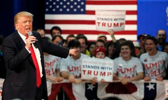 Republican presidential candidate, Donald Trump, acknowledges the young people behind him at a town hall Saturday, April 2, 2016, in Rothschild, Wis. (AP Photo/Charles Rex Arbogast)